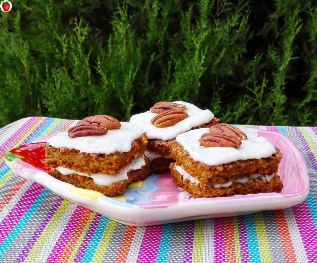 Vegan carrot cake with coconut cream frosting and pecans